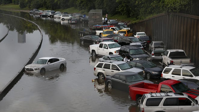 Vehicles left stranded on a flooded Interstate 45 in Houston on Tuesday.