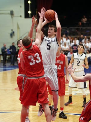 Byram Hills' Matt Groll puts up a shot against Red Hook during Tuesday's game at the County Center.