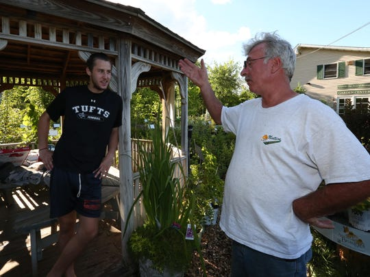 Hiker John Devine of Auburn, Massachusettes, left, talks with Pete Muroski, owner of Native Landscapes Garden Center in Pawling. Murowski invites people hiking the Appalachian Trail to stop for a rest at the garden center.