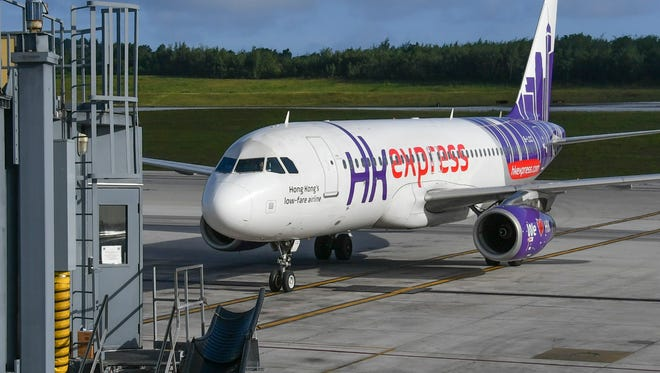 The inaugural flight of HK Express airlines arrives at the Antonio B. Won Pat International Airport on Dec. 15, 2016. According to an HK Express press release, the new route will offer service between Hong Kong and Guam four times a week.