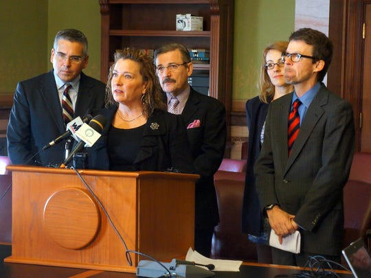Sally Gaer of Des Moines speaks at a Statehouse news