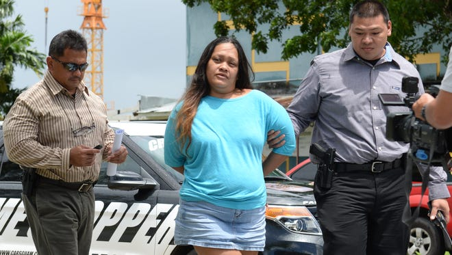 In this October 2014 file photo, Melenie Irene Margaret Villagomez Borja is escorted to the Hagatna precinct by Guam Police Depratment detectives upon her arrest. She eventually was charged with aggravated murder after her 2-month-old son died of malnutrition, but pleaded guilty to manslaughter. She was released from prison in February 2018 after a judge suspended 10 years of her 13-year sentence.