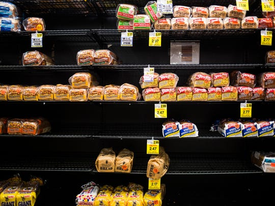 Bread shelves were emptying fast Thursday after people rushed to the Ingles market on North Main in Anderson to buy essentials Thursday in preparation for the snow forecast to arrive Friday night.