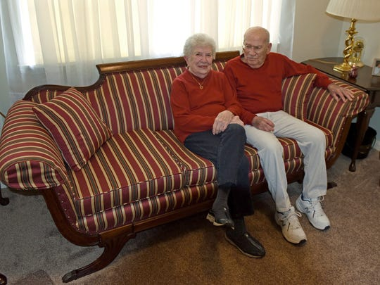 Jim and Peggy Fegan sit on the sofa that was the first real furniture they bought as a couple. They bought the 'Duncan Phyfe' style sofa in the mid-1940s for $125, and it now sits in the front bedroom of their home.