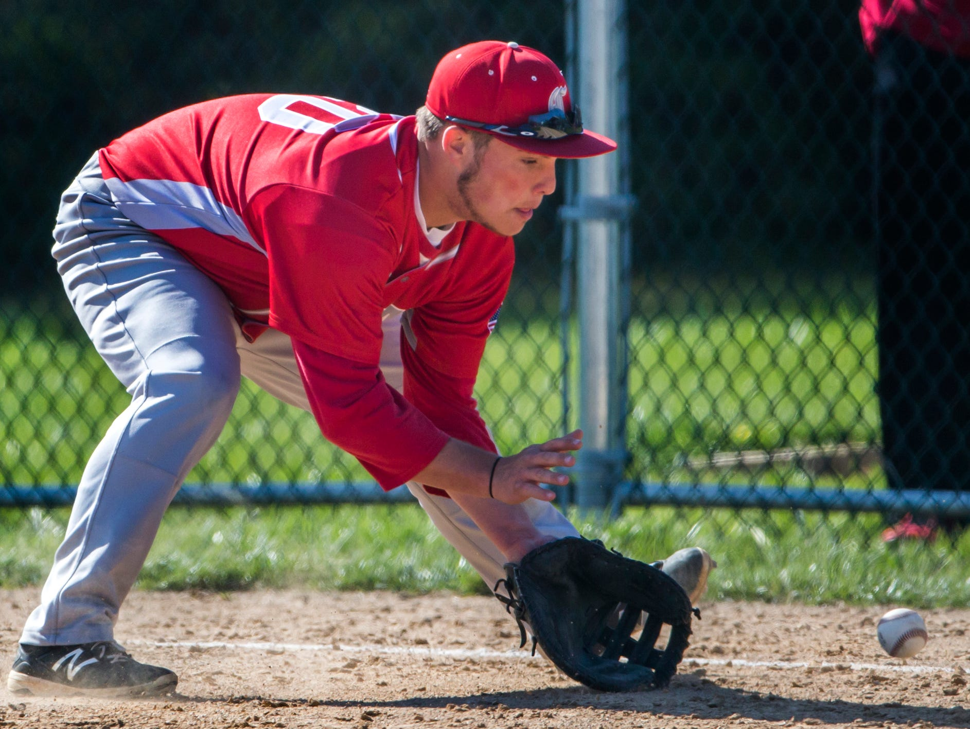 Conrad's Michael Harris fields a ball in Conrad's 11-0 win over Newark Charter on Wednesday afternoon.