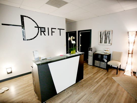 Katrina Ungvarsky keeps the lights low at The Drift Spa to help customers relax. The spa is part of a beauty center at 200 Baldwin St., Elmira.