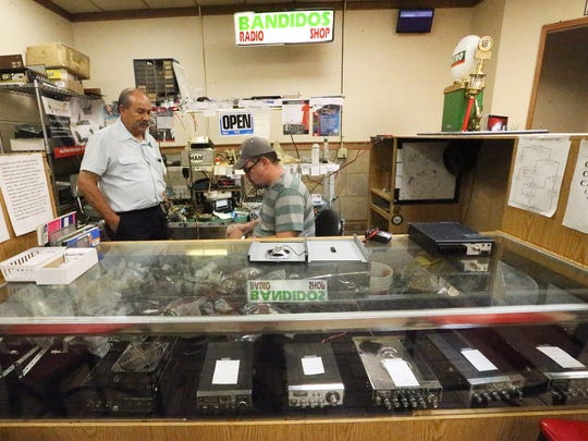 Joel Rodriguez, left, and Ricardo Rosario co-own Bandidos Radio Shop inside the Petro Stopping Center at I-10 and Horizon Blvd.