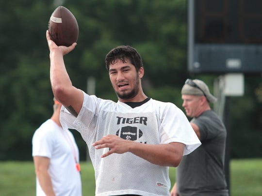AJ Epenesa of Edwardsville throws the ball during a break at practice back in August at the Edwardsville Sports Complex.