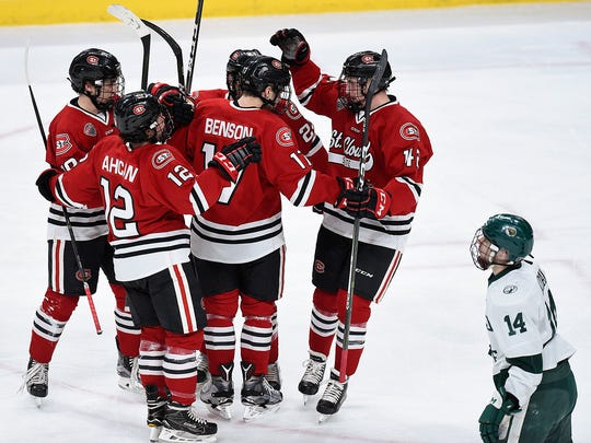 St. Cloud State's Jacob Benson, 17, celebrates his goal with teammates against Bemidji in the first period Friday, Jan. 27, during the semifinals of North Star College Cup at the Xcel Energy Center.