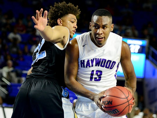 Haywood's Tristan Jarrett drives past Brainerd's Jesse Walker during their quarterfinal game, Thursday. Jarrett scored a total of 23 points to help the Tomcats to a 82-72 victory over Brainerd.