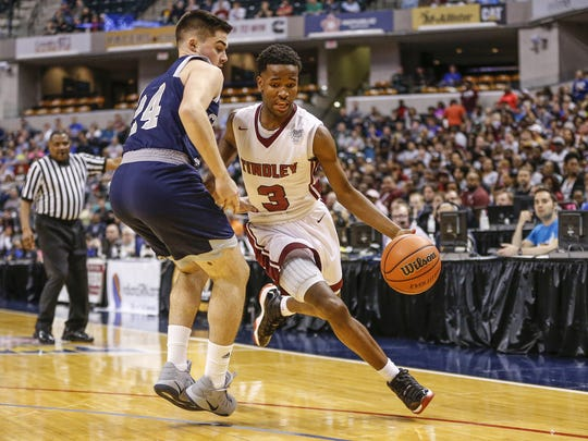 Tindley Tigers' Hunter White (3) drives against Lafayette Central Catholic KnightsÕ Thomas got hard (24) in the first half during the IHSAA Class A state championship game at Bankers Life Fieldhouse in Indianapolis on Saturday, March 25, 2017.