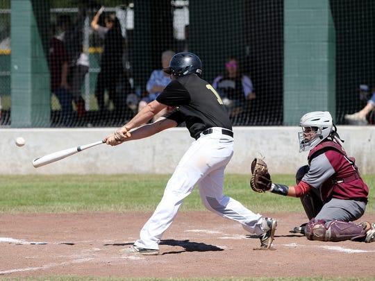 Archer City's Dawson Bolf hits a single against Seymour