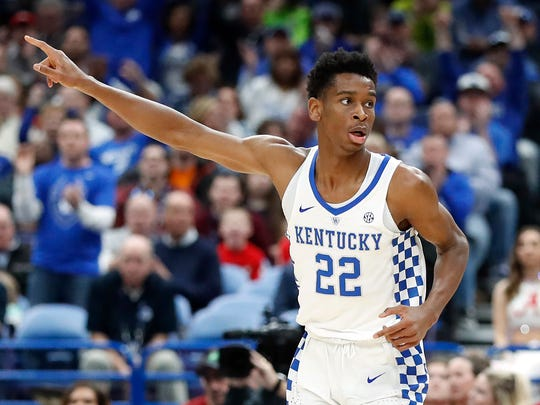 Kentucky's Shai Gilgeous-Alexander celebrates during the first half of an NCAA college basketball game against Alabama in the semifinals of the Southeastern Conference tournament Saturday, March 10, 2018, in St. Louis. (AP Photo/Jeff Roberson)