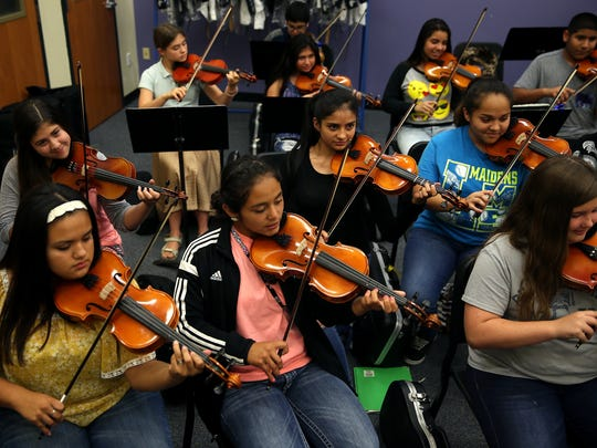 Students practice in the mariachi band program at Lincoln Middle School.