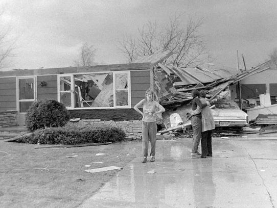 People look at the surroundings in the aftermath of the the tornado that touched down around 3:45 on Friday, April 27, 1984 in Winnebago County's Town of Clayton.