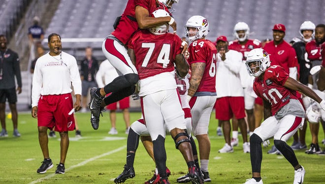 "Receiver Larry Fitzgerald celebrates after D.J. Humphries went one-on-one with Chandler Jones. ""I go out there each and every day of practice like I'm going to get fired. … We don't care what other people think. It's the guys that are in this locker room that matter,"" Jones said."