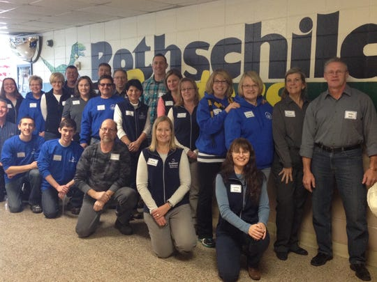 Domtar employees volunteered to read to Rothschild Elementary School students Nov. 17 to celebrate American Education Week.