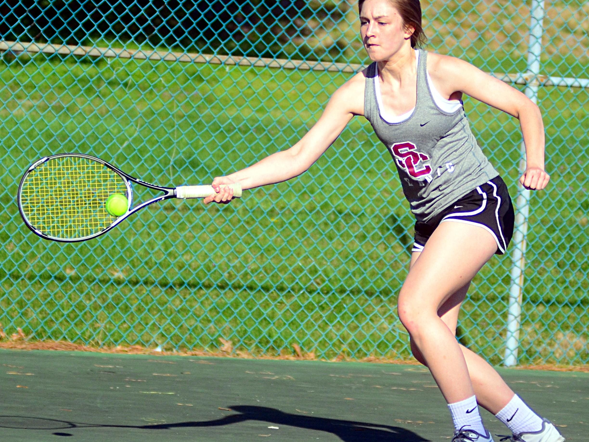 Station Camp High sophomore Jessica Hopson hits a forehand return during her match against Merrol Hyde Magnet. Hopson won in singles and doubles as the Lady Bison collected a 7-2 victory.