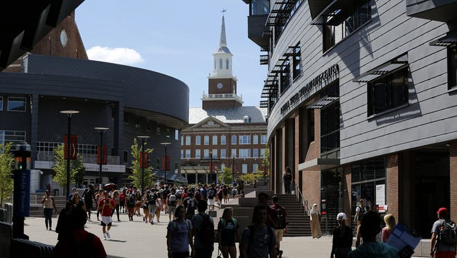 Students fill Main Street between classes at the University of Cincinnati main campus in the University Heights neighborhood of Cincinnati on Tuesday, Aug. 23, 2016.