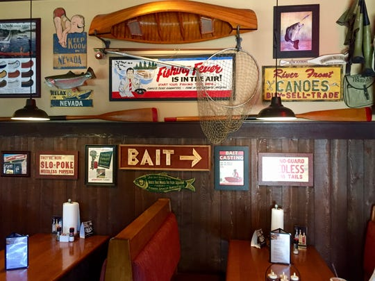 Famous Dave's wall coverings. Brett will be expelled from the Reno Foodies Facebook group for liking this.