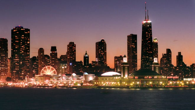 Navy Pier lights up against the Chicago skyline.