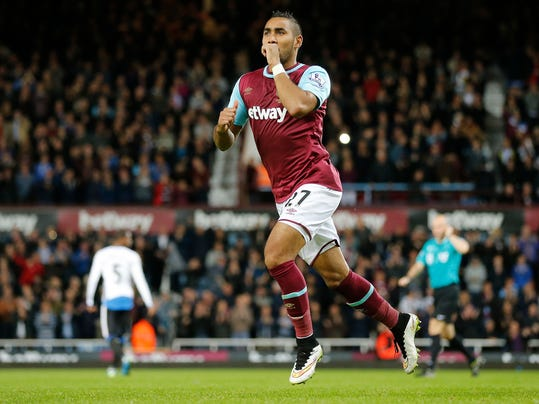 FILE- In this Monday, Sept. 14, 2015 file photo, West Ham's Dimitri Payet celebrates after scoring during the English Premier League soccer match between West Ham and Newcastle at Boleyn Ground in London. West Ham has agreed to sell France playmaker Dimitri Payet to former club Marseille for 25 million pounds ($31 million), two days before European soccer's January transfer window closes. (AP Photo/Frank Augstein, File)