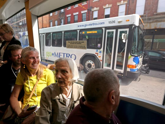 Judy Cox, of Monfort Heights, rides the Cincinnati Bell Connector with her daughter Karen Childs and Karen's husband, Dan, of White Oak, during the streetcar's opening day. It is now sharing the road with Metro buses, which like the streetcar, are run by the Southwest Ohio Regional Transit Authority.