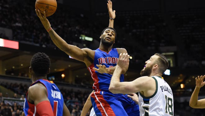 Pistons center Andre Drummond (0) takes a shot against Bucks center Miles Plumlee (18) in the first quarter Saturday in Milwaukee.