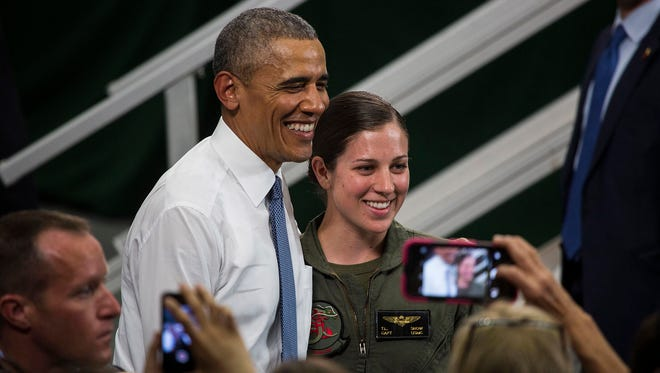 President Barack Obama poses with Capt. Tessa Snow, a MV-22B Osprey pilot with Marine Medium Tiltrotor Squadron 265, May 27, 2016. Obama recognized Snow in his speech for her actions during the Kumamoto earthquake relief efforts.