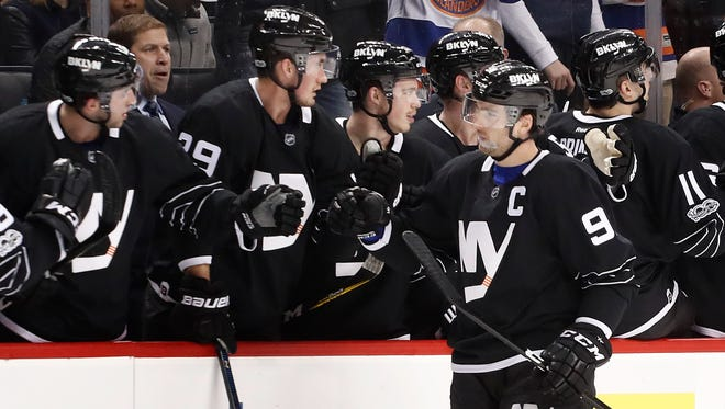 Islanders center John Tavares (91) is congratulated by teammates after scoring a goal against the Dallas Stars on Thursday, Jan. 19, 2017, in New York. The Islanders won, 3-0, and gave their coach, Doug Weight, his first victory as a head coach.