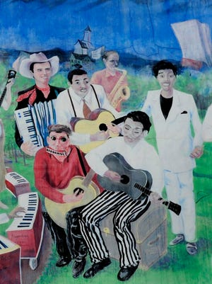 A portion of the Knoxville Music History Mural in the Old City shows music artists Pee Wee King, left, Charlie Oaks, Brownie McGhee, Jerry Coker, Stick McGhee and Clifford Curry.