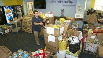 Robert Dietrick, Distribution, Community Medical Center, pushes a pallet of food for donation to local food pantries.
