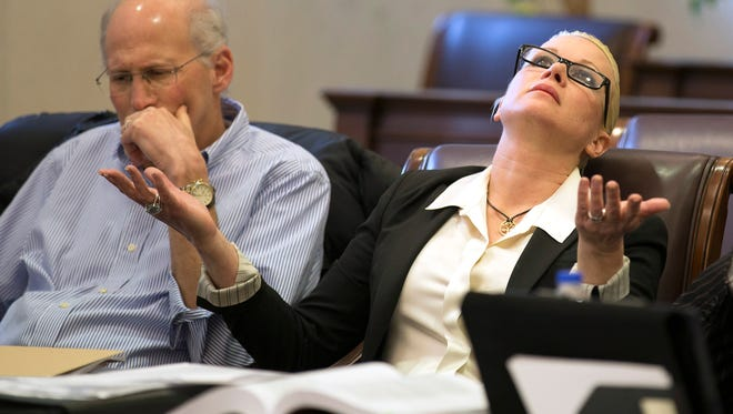 Defendant Crysta Pleatman sits with her husband, Dr. Stephen Pleatman, as Judge Jody Luebbers presents the question of whether or not both sides are willing to reach an out-of-court settlement.