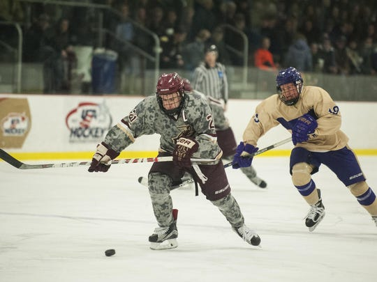 Norwich's Tyler Piacentini (10) skates down the ice