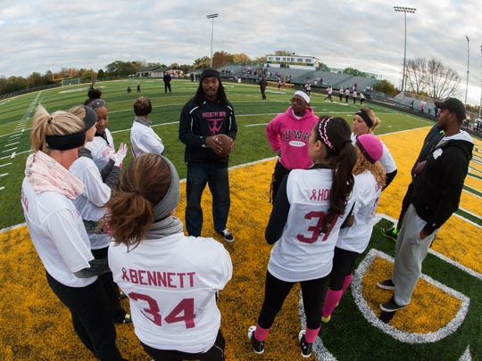 Tramon Williams coaches his team during last year's Powder Puff game.