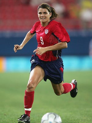 U.S. Women's National Team member Mia Hamm plays during the Olympic gold medal match on Aug. 26, 2004, in Athens, Greece. The international soccer star will be the guest speaker at this summer's Courier-Journal Sports Awards.