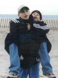 Zach Witman, front, and his younger brother, Greg, back, are seen in this photo.