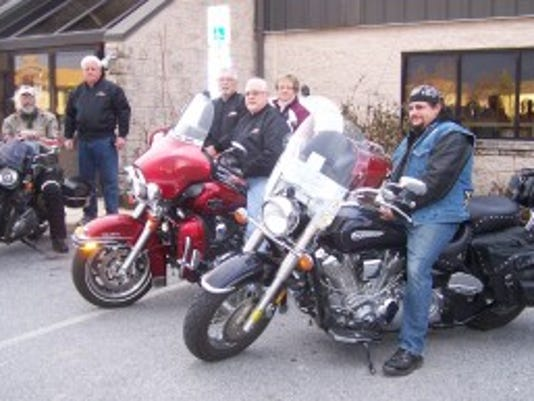 Ann Bridge, Friends president, Dover Area Community Library, meets with members of the York Motorcycle Club to launch the Bikers Book It!, a poker run fundraiser for the York County Library System Branch Libraries. (Submitted photo)