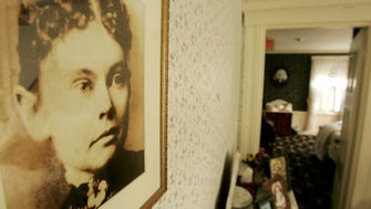 A photograph of Lizzie Borden appears in the Lizzie Borden Bed and Breakfast, in Fall River, Mass., Wednesday, Aug. 20, 2008.  The owner of the site of the 1892 double murder has filed a federal lawsuit to prevent a new museum and shop in Salem from using the name of the infamous former Sunday school teacher who was accused in the hatchet deaths of her wealthy father and stepmother. (AP Photo/Steven Senne) ORG XMIT: MASR105