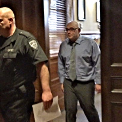 Kenneth Stahli, charged with second-degree murder for the death of 2-year-old Mason DeCosmo, exits court on Monday.