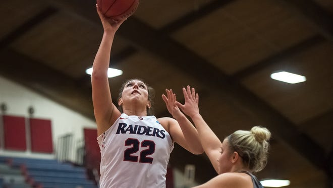 Shippensburg University's Stephanie Knauer (22) hits a layup in a game against  Bloomsburg on Wednesday. Knauer led Ship with 21 points in Saturday's overtime loss in the PSAC semifinals to IUP.