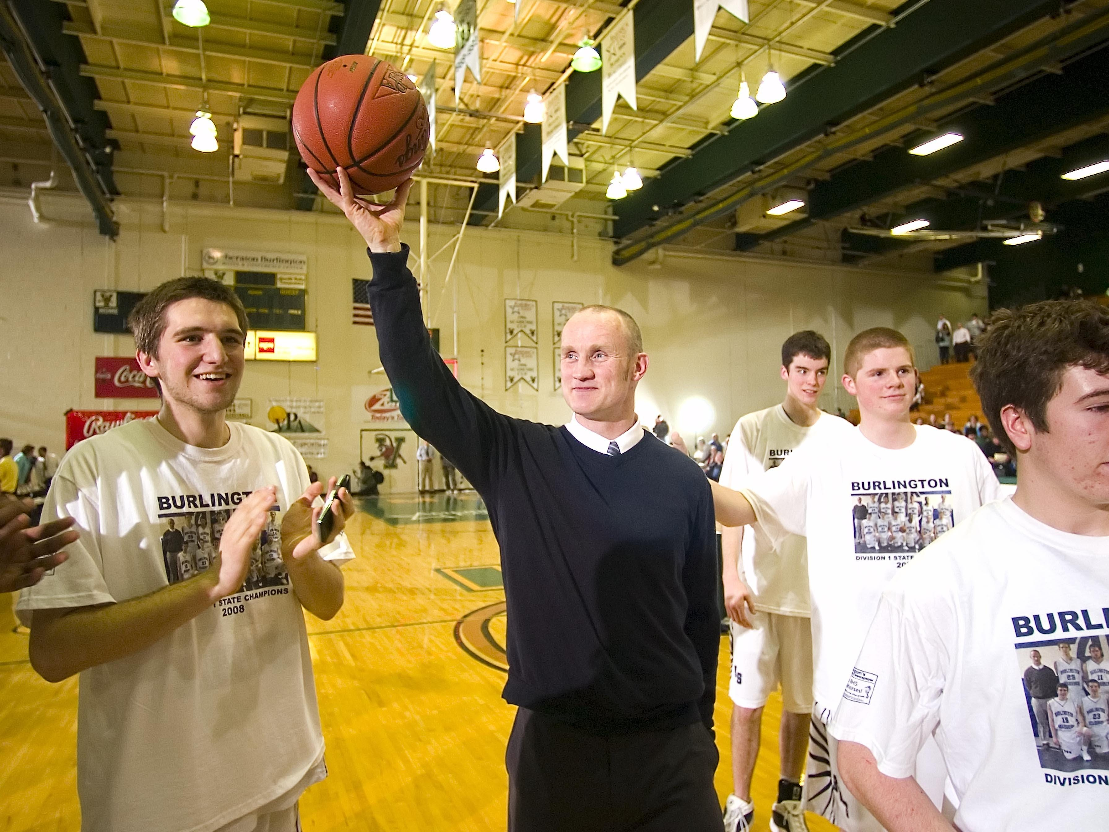 Burlington High School boys basketball coach Mat Johnson celebrates his team's undefeated season with a win over Rice Memorial High School in the Division I Boys State Championship at the University of Vermont's Patrick Gymnasium on Monday March 3, 2008. (GLENN RUSSELL, Free Press)