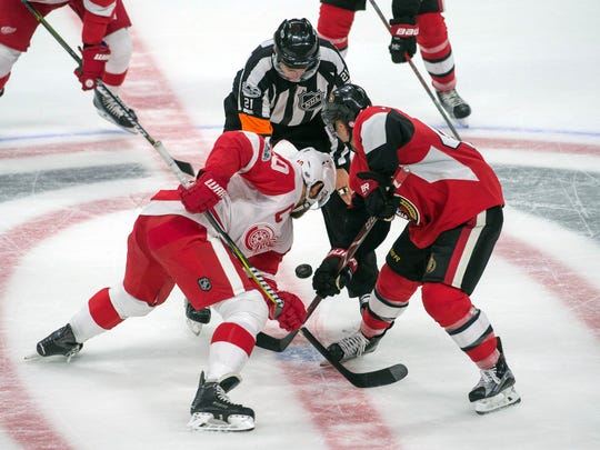 Oct 7, 2017; Ottawa, Ontario, CAN; Red Wings center Henrik Zetterberg faces off against Senators center Jean-Gabriel Pageau in overtime at Canadian Tire Centre.