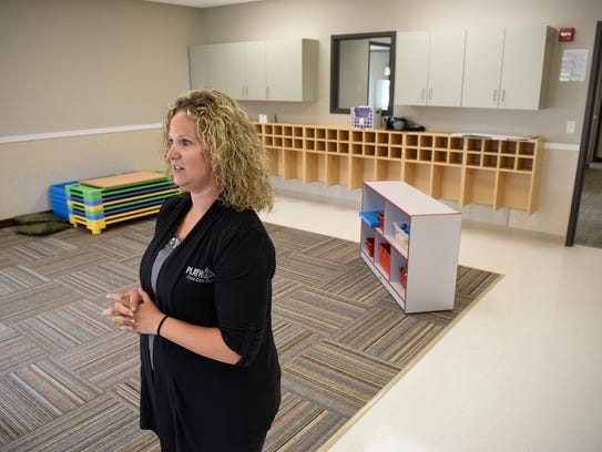 Center director Kelly Haase stands in one of the new