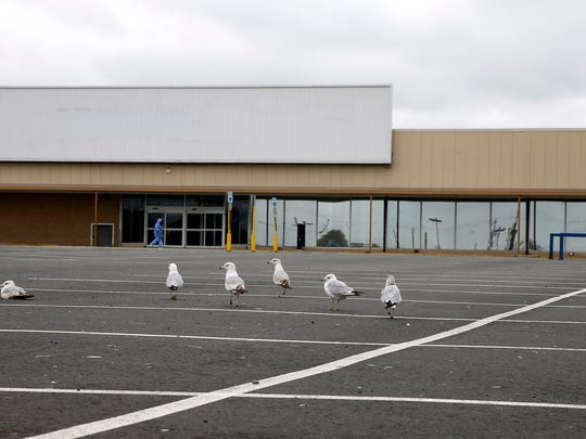 The site of the proposed Hazlet Town Center is now home of empty storefronts and parking lot with major retail sites empty.  It is shown on Wednesday, April 19, 2017