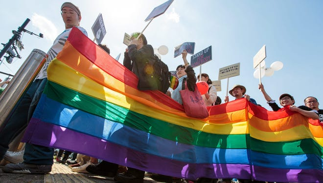 Participants attend the Tokyo Rainbow Pride parade in on April 26, 2015.