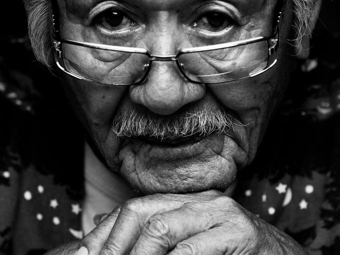 George Billie, 86, grew up in a remote Seminole traditional village and is one of the ground keepers at his Ah-Tha-Thi-Ki Museum at the Big Cypress Seminole Reservation.  He is a member of the Seminole Reservation and attends celebrations and events for the Seminole and Miccosukee tribes.  The Billie name is prominent on the Big Cypress Reservation because the family helped pave the way for reservation status.