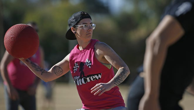 The Pit Crew's Morgan Plumbo throws out a Bromosas player at first base during The Phoenix Fire Kickball League at Encanto Park on Jan. 28, 2018, in Phoenix.