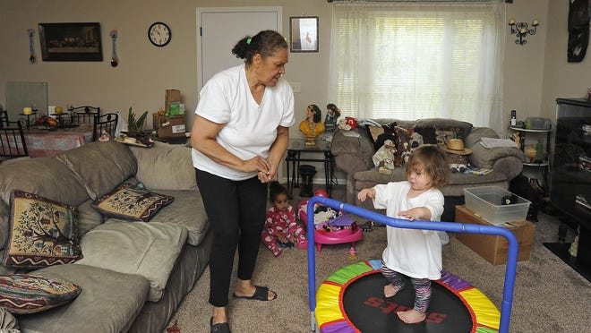 Xenia Gutierrez watches her granddaughters Xenia Elnora Gutierrez (pink) and Milania Nicole Garcia at her home in Sioux Falls. Gutierrez lives in a GovernorÕs home placed in an older neighborhood.