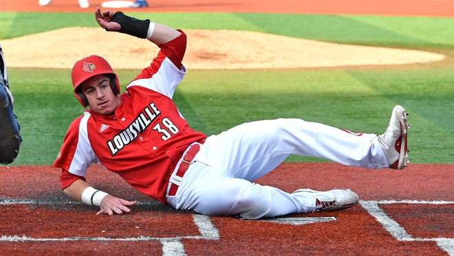 Louisville's Brendan McKay (38) slides to score a run during their game against Kentucky at Jim Patterson Stadium, Tuesday, April. 4, 2017 in Louisville Ky.